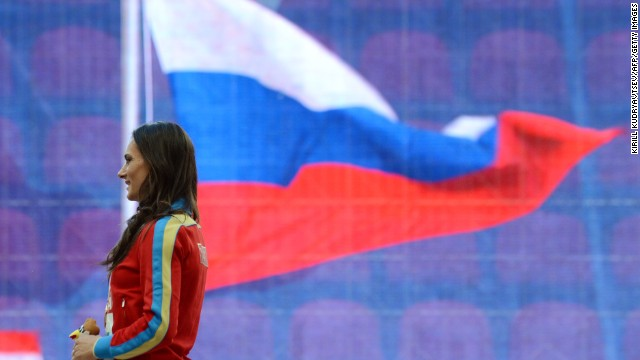 Russian pole vault star Yelena Isinbayeva launched a staunch defense of her country's new anti-gay laws after receiving her gold medal at the World Athletics Championships in Moscow Thursday.