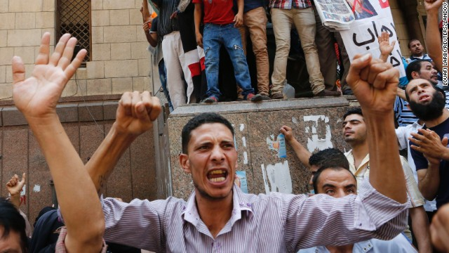 A Morsy supporter takes part in a protest near Ennour mosque in Cairo on August 16.