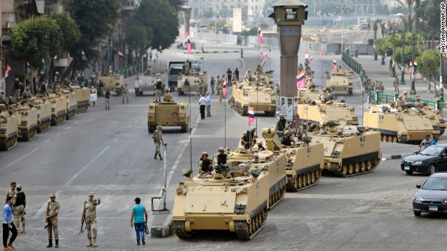 Egyptian soldiers take positions alongside armored vehicles as they guard the entrance to Tahrir Square in Cairo on Friday, August 16.