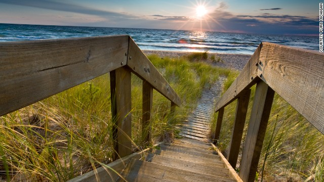 Sleeping Bear Dunes National Lakeshore occupies 35 miles on Lake Michigan's eastern coastline and is home to hiking trails, museums, an 1871 lighthouse and a historic farm district.