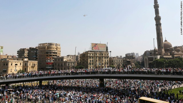 A military helicopter flies above demonstrators in Cairo on August 16.