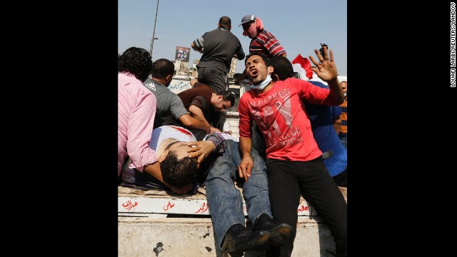 Demonstrators hurt in the clashes at Ramses Square are taken away on August 16 in Cairo.