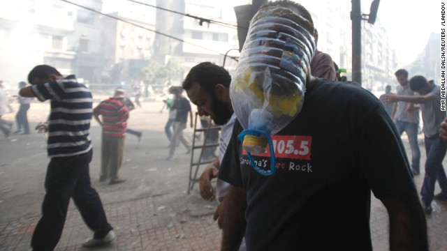 A Muslim Brotherhood member and Morsy supporter wears a gas mask made out of a plastic bottle during clashes in front of the Azbkya police station on August 16.
