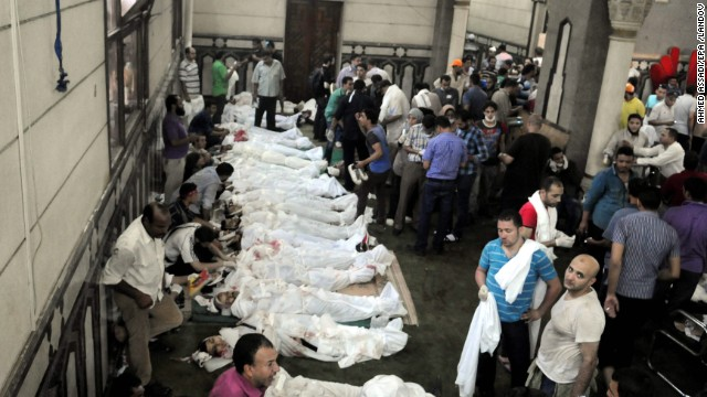 Bodies of protesters who died during clashes are laid out at the Al-Fateh mosque on August 16.