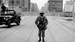 Freed was haunted by this photo he took of a black soldier guarding the Berlin Wall in 1961, author Paul Farber says.