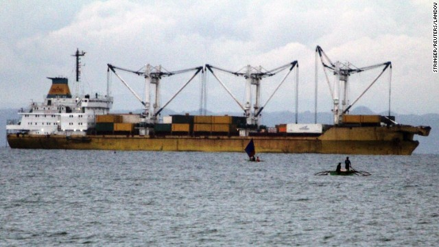 A cargo vessel is docked at sea after colliding with and sinking a ferry on Friday, August 16.