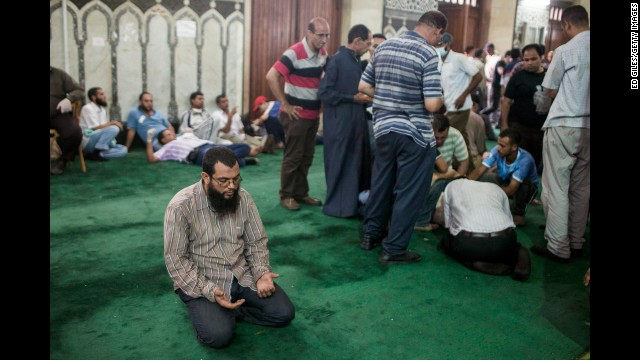 A Morsy supporter prays on the floor of the Al-Fateh mosque in Ramses Square as injured protesters are treated nearby on Friday, August 16.