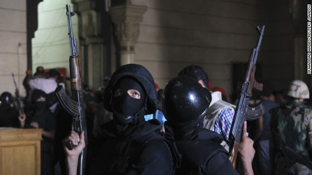 Policemen stand guard inside a room of Al-Fateh mosque as supporters of ousted president Mohamed Morsy ex