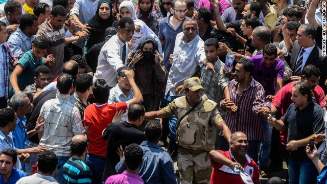 An army officer escorts an Islamist woman out of Cairo's Al-Fateh mosque on August 17.