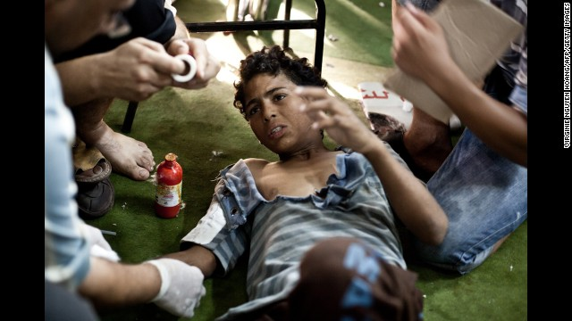 A wounded boy is treated in the Taamin Sehi field hospital during clashes on August 16.