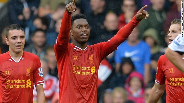 Daniel Sturridge celebrates after scoring Liverpool's opening goal at Anfield on Saturday.