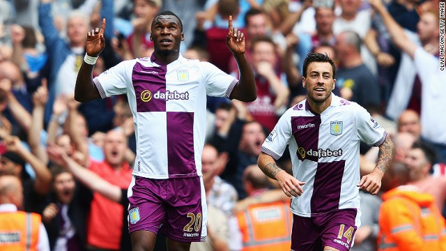 Aston Villa's Christian Benteke celebrates scoring his second goal from the penalty