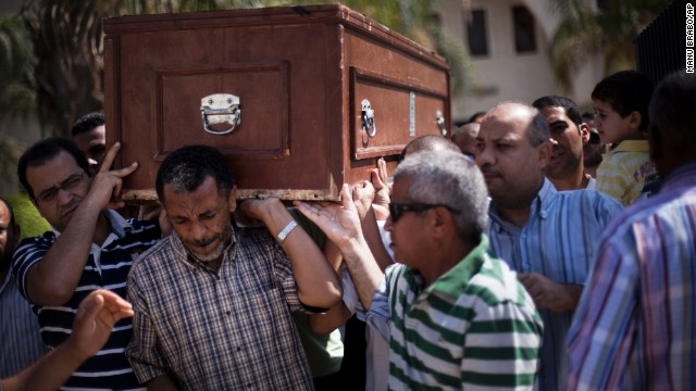 Friends and relatives of Ammar Badie, 38, killed Friday during clashes in Ramses Square, carry his coffin during his funeral in Al-Hamed mosque in Cairo on August 18. Ammar Badie was the son of the Muslim Brotherhood's spiritual leader, Mohammed Badie.