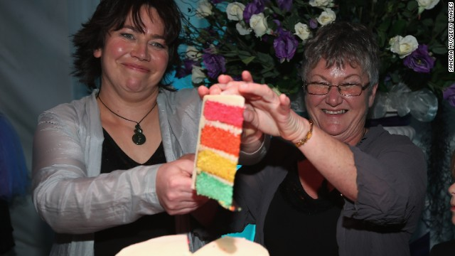 Newlyweds Lynley Bendall (L) and Ally Wanikau (R) cut their wedding cake during their reception inside the Air New Zealand hangar in Auckland on August 19. They were married onboard a specially-arranged Air New Zealand flight from Queenstown to Auckland.