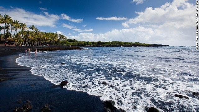 Located south of Hawaii Volcanoes National Park, Punaluu Black Sand Beach gets its color from volcanic activity and is also known for sea turtle sightings.