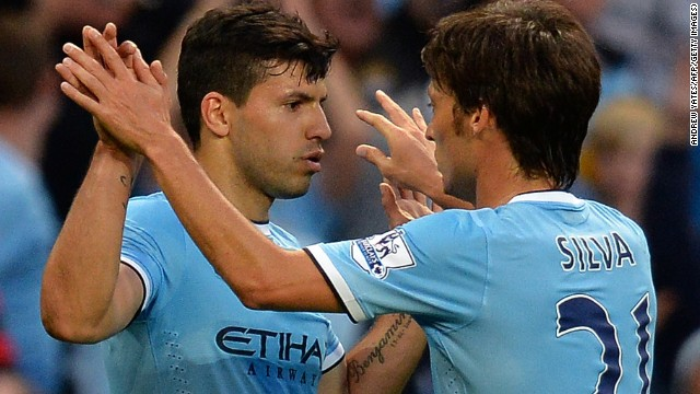 Sergio Aguero and David Silva celebrate scoring for Manchester City to help set up victory against Newcastle.