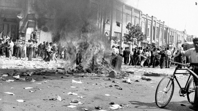 A communist newspaper's office equipment is burned in the streets of Tehran on August 19, 1953, during the pro-Shah riot that swept through Iran's capital. After a day of fighting, Royalist forces triumphed and Prime Minister Mohammad Mossadegh was ousted. A declassified CIA document acknowledges that the agency was involved in the coup.