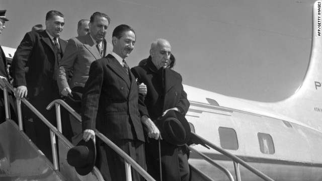 Former Iranian Prime Minister Mohammad Mossadegh steps off a plane in late August 1953. He was imprisoned for three years and put under house arrest until his death in 1967.