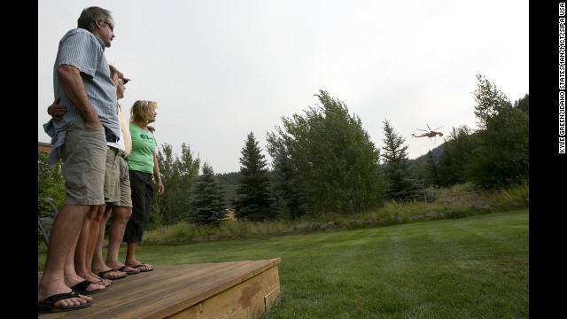 Charlie Pomeroy, left, Stacey Ward, Rusty Hollinger and Suzy Hayes watch a sky crane fill up on fire retardant on August 19.