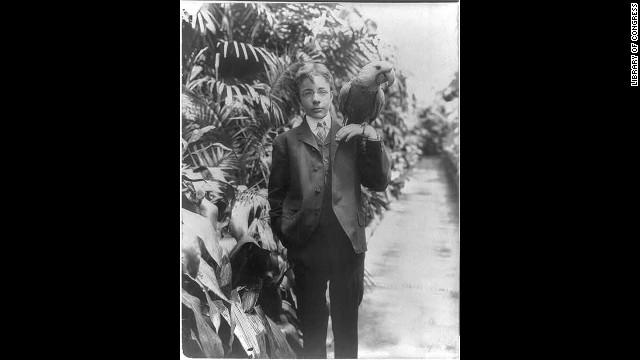 President Theodore Roosevelt's eldest son, Teddy Jr., holds his macaw, Eli.