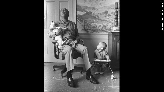 President Lyndon Johnson sings with dog Yuki while his grandson, Patrick, watches at the LBJ Ranch in 1968.