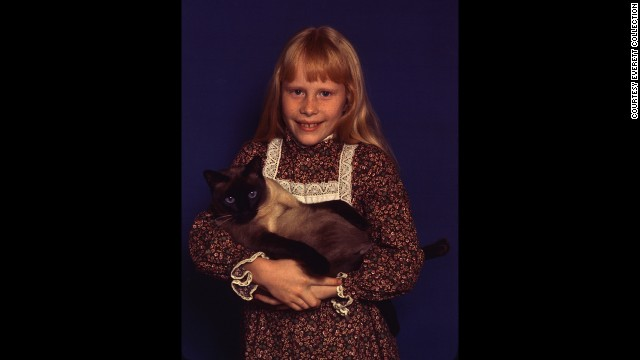 President Jimmy Carter's daughter, Amy, holds her Siamese cat Misty Malarky Ying Yang.