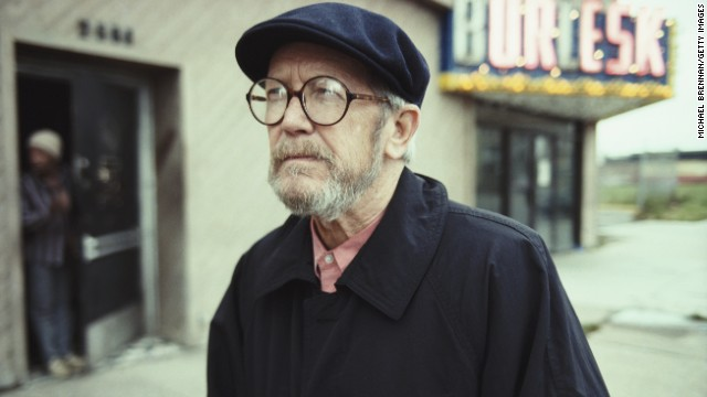 Leonard walks down a street in Detroit in November 1992.