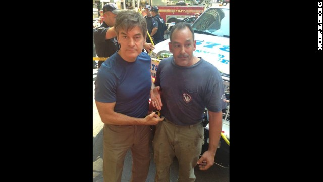Dr. Mehmet Oz, left, and plumber David Justino assisted at the scene of a car accident when a woman was hit by a taxi in New York.