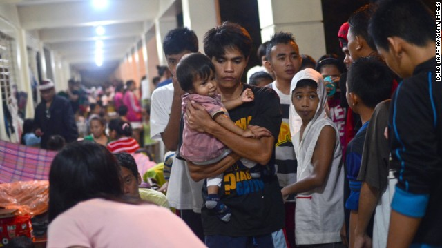 Filipinos take shelter in an elementary school that has been turned into an evacuation center in Marikina City on August 20.