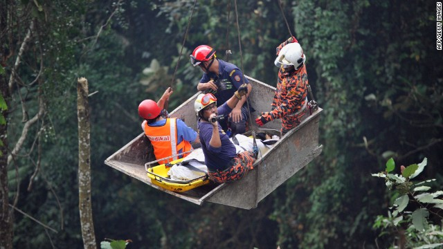 Emergency services personnel rescue a passenger after a bus fell into a ravine near the Genting Highlands on August 21, 2013.