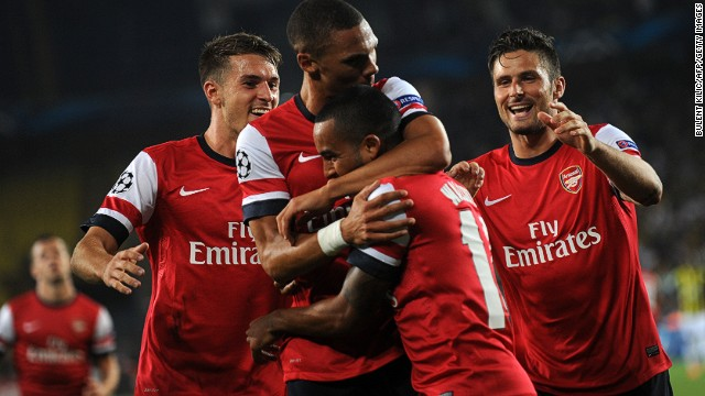 Kieran Gibbs (center left) is mobbed after scoring Arsenal's opening goal in Tu