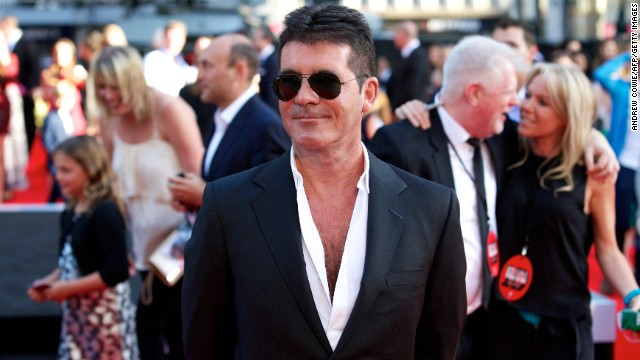 Simon Cowell: 'I'm proud to be a dad'