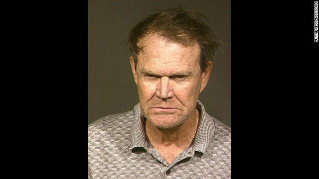 Country singer Glen Campbell was arrested in Phoenix on November 25, 2003, on drunken driving and hit-and-run charges. According to Arizona police, the 67-year-old performer hit another car and left the scene. He was later picked up at his home where he smelled of booze and kneed a sergeant in the thigh. Seen Campbell poses for his mugshot in 2004 after checking into a Phoenix lockup to serve his first of 10 nights in jail. He pleaded guilty to the charges.