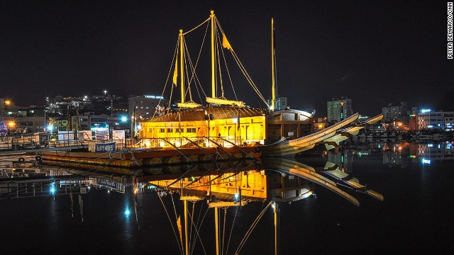 "A replica of Geobukseon (""Turtle Ship""), a famous Korean battleship that defended the country from Japanese attack, sits in Tongyong Harbor. Admiral Yi Sun Shin won a famous victory against the Japanese here; Bijindo was given its name in honor of that victory."