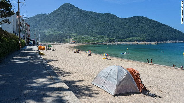 Camping on the beach may be preferable to staying in a hotel, which are scarce on the island. There's a public bathroom and shower just behind the beach.