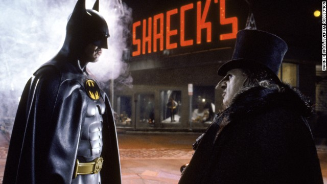 "Twenty years after Adam West's Batman came Michael Keaton in Tim Burton's 1989 ""Batman."" He played more of a dark, explosive Batman, the opposite of West's goofy type. Keaton's performance received favorable reviews, and he became the first actor to reprise the role in 1992's ""Batman Returns"" with Danny DeVito as the Penguin."