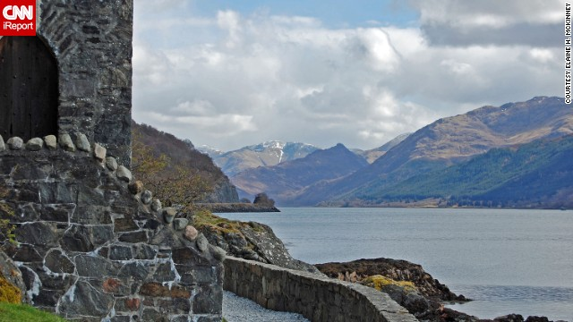 "The Highlands of Scotland, seen here from <a href='http://ireport.cnn.com/docs/DOC-985075'>Eilean Donan Castle</a>, are ""beautiful with a touch of snow on the mountains,"" says Elaine McKinney."