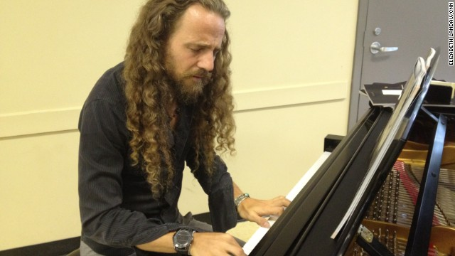 Nacho Arimany improvises on piano at the conference. He's collaborating with a company called Advanced Brain Technologies to compose music aimed at benefiting the brain.