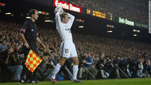 Football star and fashion icon David Beckham swapped Manchester United for Real in 2003. After four years in the Spanish capital, Beckham headed to the United States, joining the Los Angeles Galaxy. BARCELONA, SPAIN - DECEMBER 6: David Beckham of Real Madrid gets set for a throw in as he is closely watched by the media during the Spanish Primera Liga match between Barcelona and Real Madrid at the Nou Camp Stadium on December 6, 2003 in Barcelona, Spain.