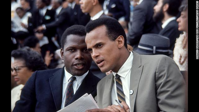 Actor Sidney Poitier, left, and Singer Harry Belafonte talk with one another during the march.