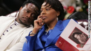 Bernice King confers with Bishop Eddie Long during a 2006 funeral service for her mother at Long\'s church.\n
