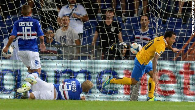 Argentine striker Carlos Tevez celebrates scoring Juventus' winner against Sampdoria at Stadio Luigi Ferraris.