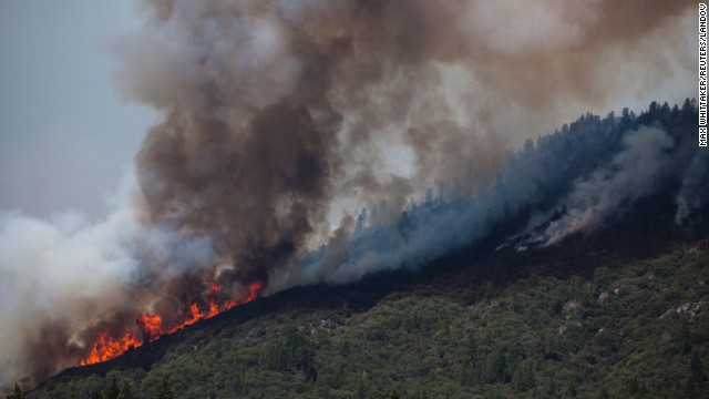 Smoke and flames move along a ridge just outside Yosemite National Park on August 24.