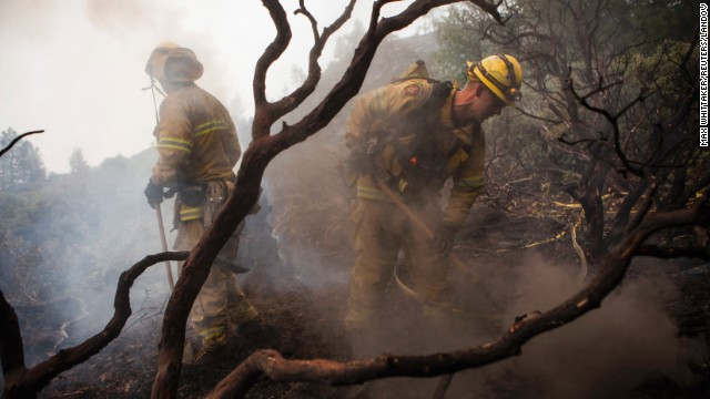 El Dorado Hills firefighters work to douse a hotspot in Yosemite National Park on August 24. Nearly 3,000 firefighters are attempting to bring the fast-moving fire under control.