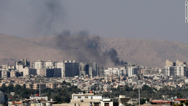 Columns of smoke rise in Barzeh after heavy shelling on Friday, August 23.