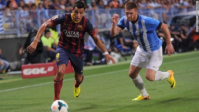Barcelona's match-winner Adriano Correia gets past Malaga's Vitorino Antunes at La Rosaleda Stadium.