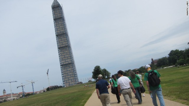In Ingress, real-life landmarks, like the Washington Monument, serve as in-game