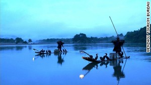 The Nanxi River -- where travelers can watch local fishermen team with cormorants to catch fish.