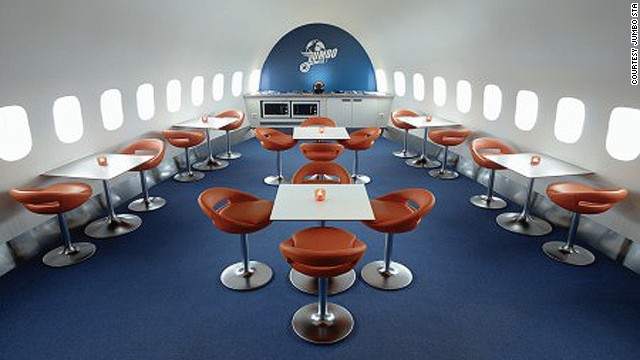 With commercial seats removed, airplanes look surprisingly larger inside. This is the dining area at Jumbo Stay.