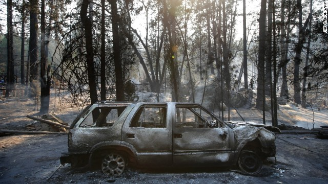 A burned SUV sits in front of a campground destroyed by the fire near Yosemite National Park on August 26.
